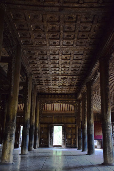 Teak pillars of Golden Palace Monastery Mandalay Myanmar